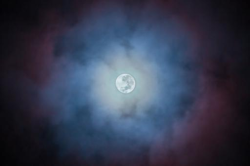 Full moon on blue night background